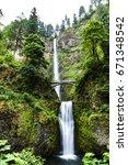 beautiful cascading multnomah... | Shutterstock . vector #671348542