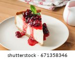 cheesecake with cherry sauce on ... | Shutterstock . vector #671358346
