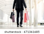 businessman holding shopping... | Shutterstock . vector #671361685