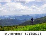 girl on green mountain hill... | Shutterstock . vector #671368135