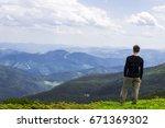male on green mountain hill... | Shutterstock . vector #671369302