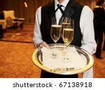 Waiter welcomes guests - stock photo