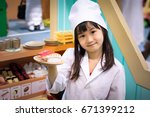 asian girl role play as a sushi ... | Shutterstock . vector #671399212
