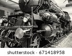 Steam locomotive in national technical museum in Prague, Czech Republic. The transportation history exhibit. Black and white photo. - stock photo