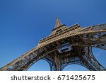 eiffel tower in paris against... | Shutterstock . vector #671425675