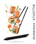 sushi pieces placed between... | Shutterstock . vector #671427718