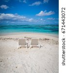 sun oungers at the beacht of a... | Shutterstock . vector #671443072