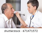 kid examines his grandfather... | Shutterstock . vector #671471572