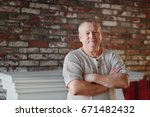 the old man in his house stands ... | Shutterstock . vector #671482432
