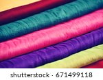 stack of colorful clothes | Shutterstock . vector #671499118