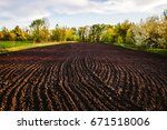 black soil plowed field. earth... | Shutterstock . vector #671518006