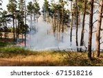 Small photo of Forest fire. Using firebreak for stoping wildfire