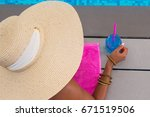 girl holding summer blue... | Shutterstock . vector #671519506