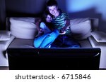 couple on couch watching tv  ...   Shutterstock . vector #6715846