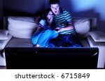 couple on couch watching tv  ...   Shutterstock . vector #6715849