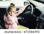 funny little girl with her... | Shutterstock . vector #671586592