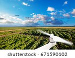 drone with a camera on a green... | Shutterstock . vector #671590102