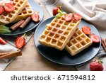 delicious cinnamon waffles with ...   Shutterstock . vector #671594812