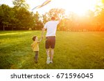 father wearing white t shirt... | Shutterstock . vector #671596045
