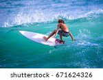 riding the waves. costa rica ... | Shutterstock . vector #671624326