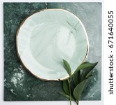 ceramic plates with green... | Shutterstock . vector #671640055