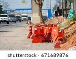 Small photo of Water barrier used for dividing And arrange an emergency traffic system to block the car or want to change the route. Can be arranged in a long line.