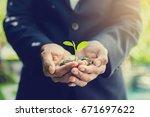 business man holding little... | Shutterstock . vector #671697622