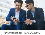 two business people discuss... | Shutterstock . vector #671702242