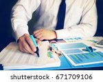 Small photo of Businessman checking accounting data in an office.