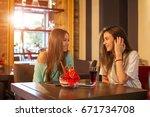 two teenage girls talking in... | Shutterstock . vector #671734708