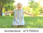 cute little girl sitting on...   Shutterstock . vector #671750422