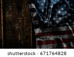 usa flag on a wood surface | Shutterstock . vector #671764828