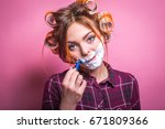 woman in curlers shaves | Shutterstock . vector #671809366