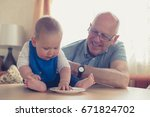 a grandfather is sitting at a... | Shutterstock . vector #671824702