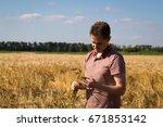 agronomist on barley  cereal...   Shutterstock . vector #671853142