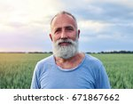 portrait of smiling elderly... | Shutterstock . vector #671867662