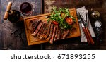 sliced grilled beef barbecue... | Shutterstock . vector #671893255