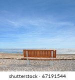 Bench On Rocky Vacation Beach...