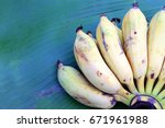 organic bananas on banana leaf... | Shutterstock . vector #671961988