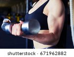 cropped shot of athletic young... | Shutterstock . vector #671962882