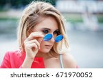 beautiful young blond girl with ... | Shutterstock . vector #671970052