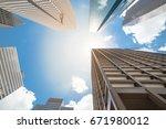upward view of skyscrapers... | Shutterstock . vector #671980012