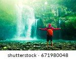 happy man backpacker enjoying... | Shutterstock . vector #671980048
