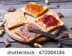 nut nougat cream with chocolate ... | Shutterstock . vector #672004186