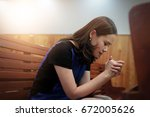 woman praying in the church ... | Shutterstock . vector #672005626