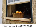 basket with fresh bright... | Shutterstock . vector #672020242