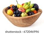 wooden fruit bowl isolated over ... | Shutterstock . vector #672046996