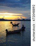 Small photo of Sea view and fisherman boats at Phithak island at sunset is recommended. It makes us relax after all day fun at the island which is in Chumphon Province, Thailand.