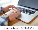 hands with laptop typing  | Shutterstock . vector #672052915