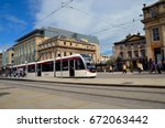 edinburgh tram line passing by... | Shutterstock . vector #672063442